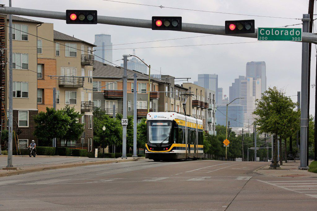 The Dallas streetcar approaches the intersection of Zang and Colorado as it ambles along its route in Oak Cliff just past the Oakenwald stop.