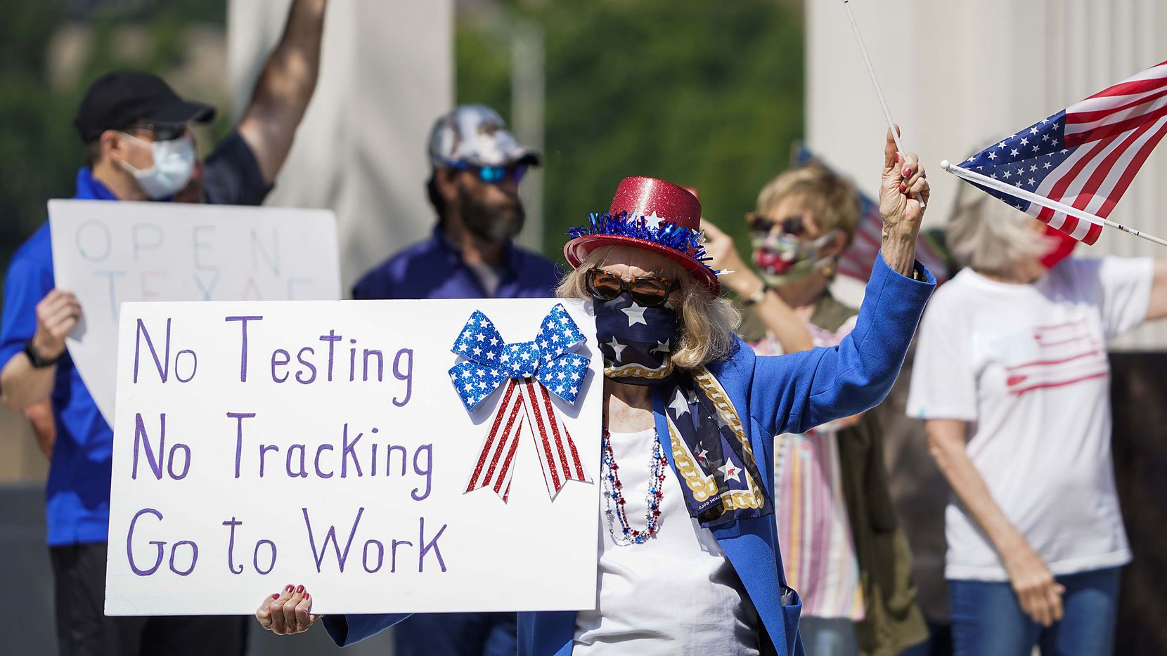Protesters rally against stay-at-home orders at Dealey Plaza on Tuesday.