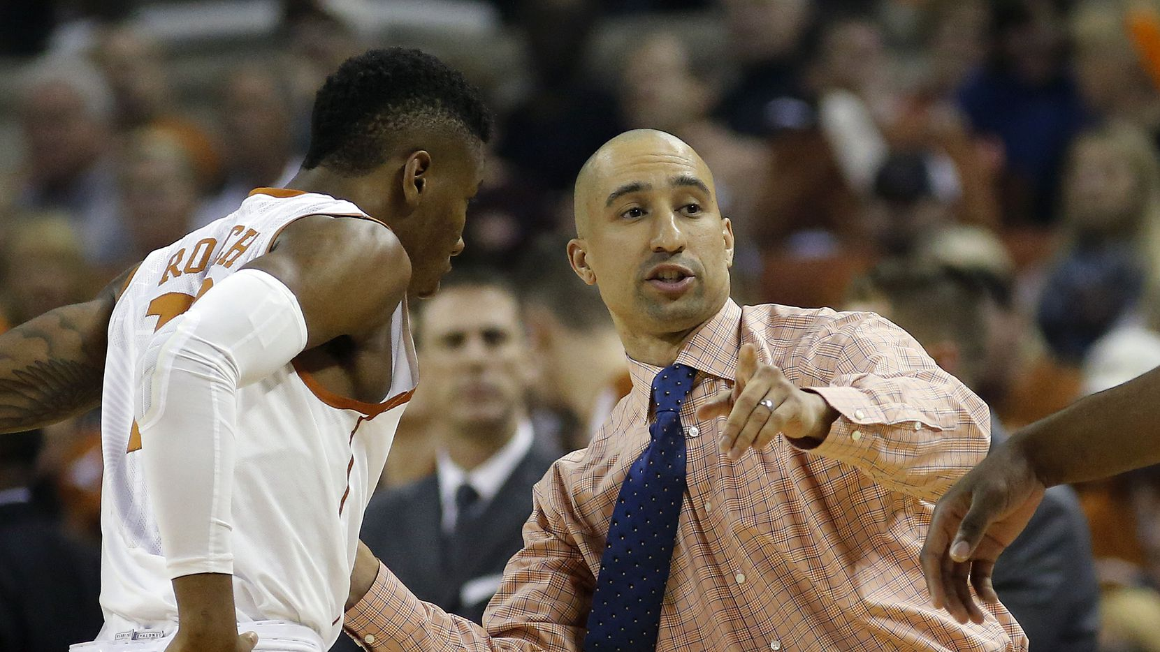 AUSTIN, TX - DECEMBER 12: Head coach Shaka Smart of the Texas Longhorns talks with Kerwin Roach Jr. #12 during the game with the North Carolina Tar Heels at the Frank Erwin Center on December 12, 2015 in Austin, Texas. (Photo by Chris Covatta/Getty Images)