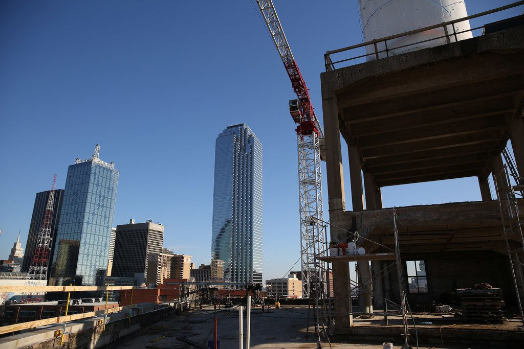Bank of America tower and other downtown buildings can  be seen during a tour of the Blue Cross Blue Shield C1 Innovation Lab at 603 Munger Avenue in Dallas Thursday January 19, 2017. The lab will help to promote new ideas in health care. Blue Cross Blue Shield is occupy the sixth and seventh floors of the former Brown Cracker and Candy Co. building, which was built in 1903. (Andy Jacobsohn/The Dallas Morning News)
