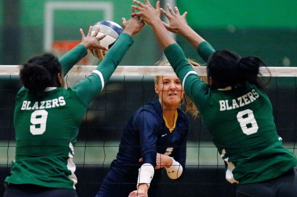 Highland Park High School outside hitter Kate Nugent (2) has a hit blocked by Lebanon Trail High School middle Ashia Dorsey (9) and Lebanon Trail High School opposite Tyrah Ariail (8) during game one as Lebanon Trail High School played Highland Park High School in a Class 5A Region II quarterfinal match played at Richardson Berkner High School on Monday night, November 12, 2019. (Stewart F. House/Special Contributor)