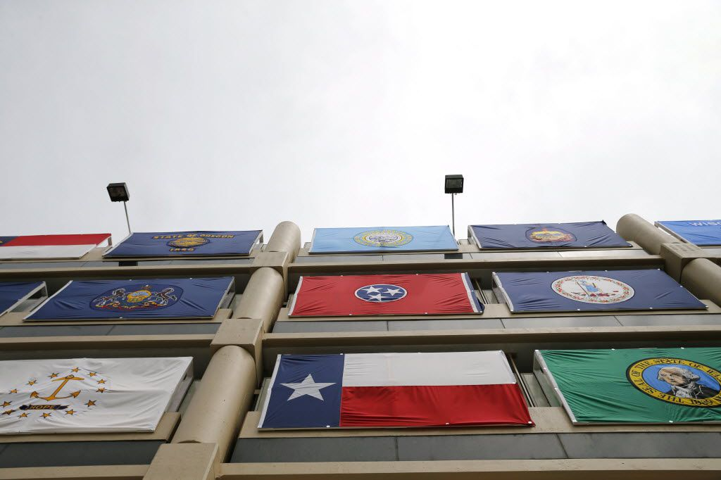 Texas flag amongst other state flags draped on a parking garage across the street from Quicken Loans Arena, the location for the Republican National Convention in Cleveland, Ohio on Saturday, July 16, 2016. (Vernon Bryant/The Dallas Morning News)