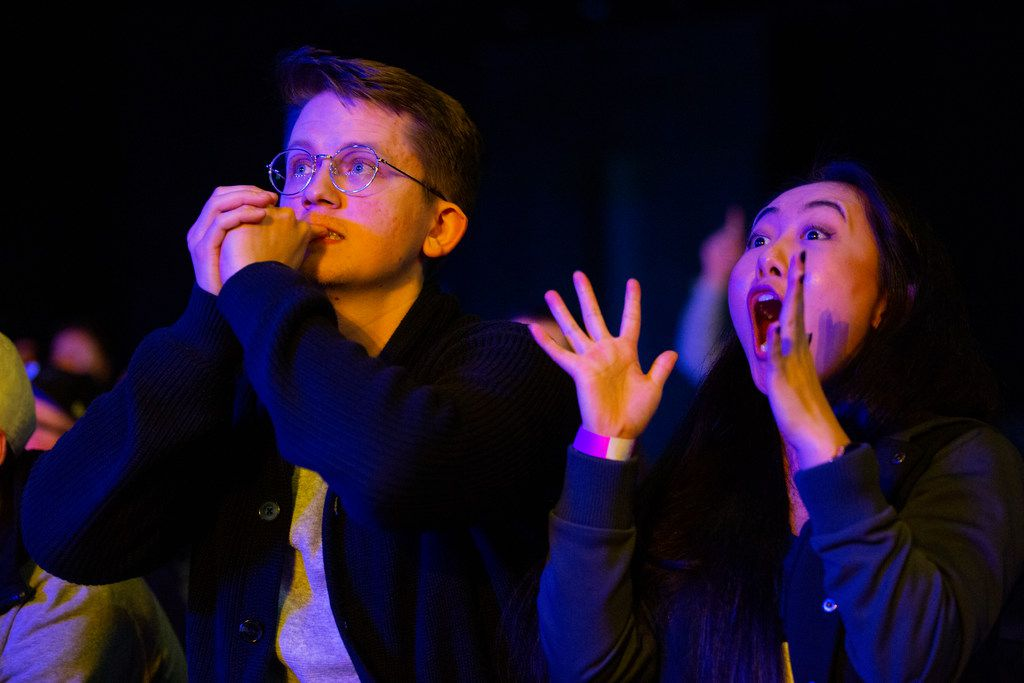 Oscar Vallner (left) and Daisy Wang from Dallas hold their breath as the Dallas Fuel leads in the third map during the season three opening weekend  match of the Overwatch League against the San Francisco Shock on Feb. 9, 2020 at the Esports Stadium in Arlington. The Fuel lost 3-1. (Juan Figueroa/ The Dallas Morning News)