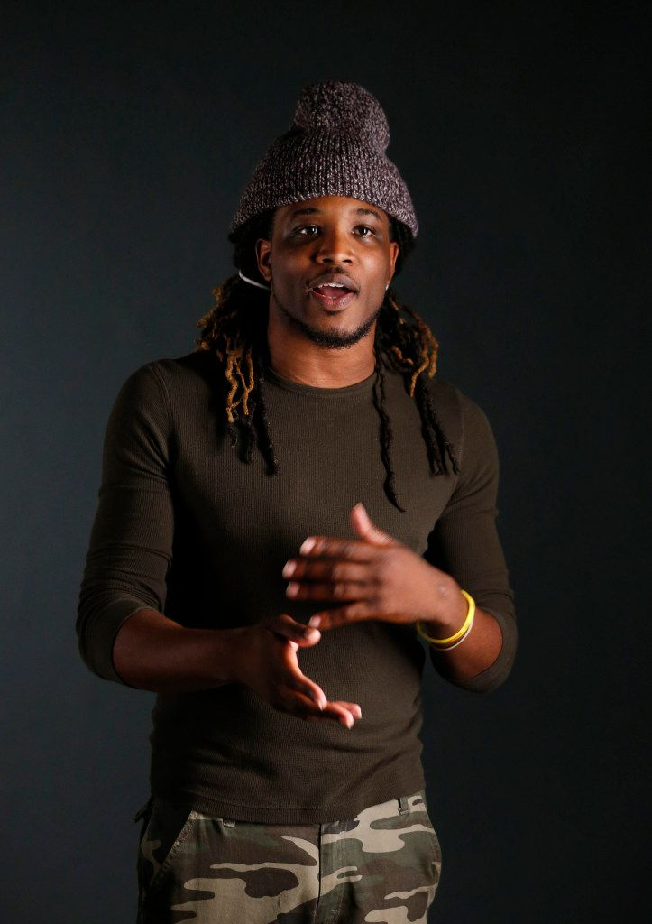 Tro'juan Henderson poses for a portrait in studio in Dallas on Tuesday, April 18, 2016. Henderson, a 28-year-old Lyft driver, has gone viral after he refused to pick up an intoxicated woman in Dallas. He's an advocate against sexual assault and a spoken word poet. (Vernon Bryant/The Dallas Morning News)