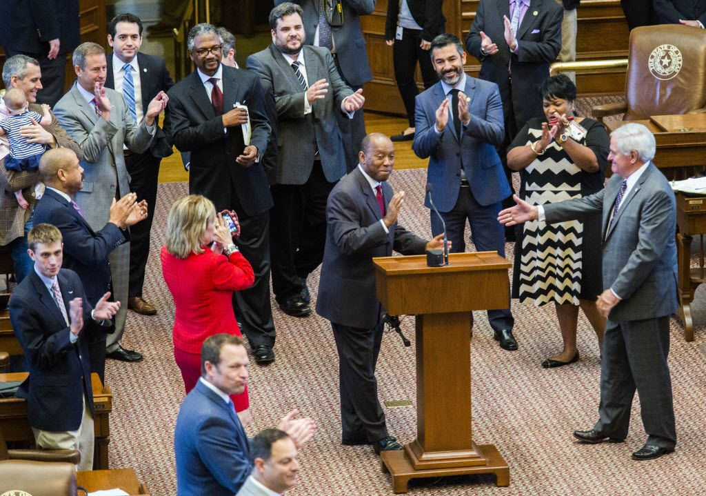 Representatives applaud as Rep. Sylvester Turner, D-Houston, center, moves adjournment sine die for the House of Representatives, ending the 84th Texas legislature regular session on Monday, June 1, 2015 at the Texas state capitol in Austin, Texas.   (Ashley Landis/The Dallas Morning News)