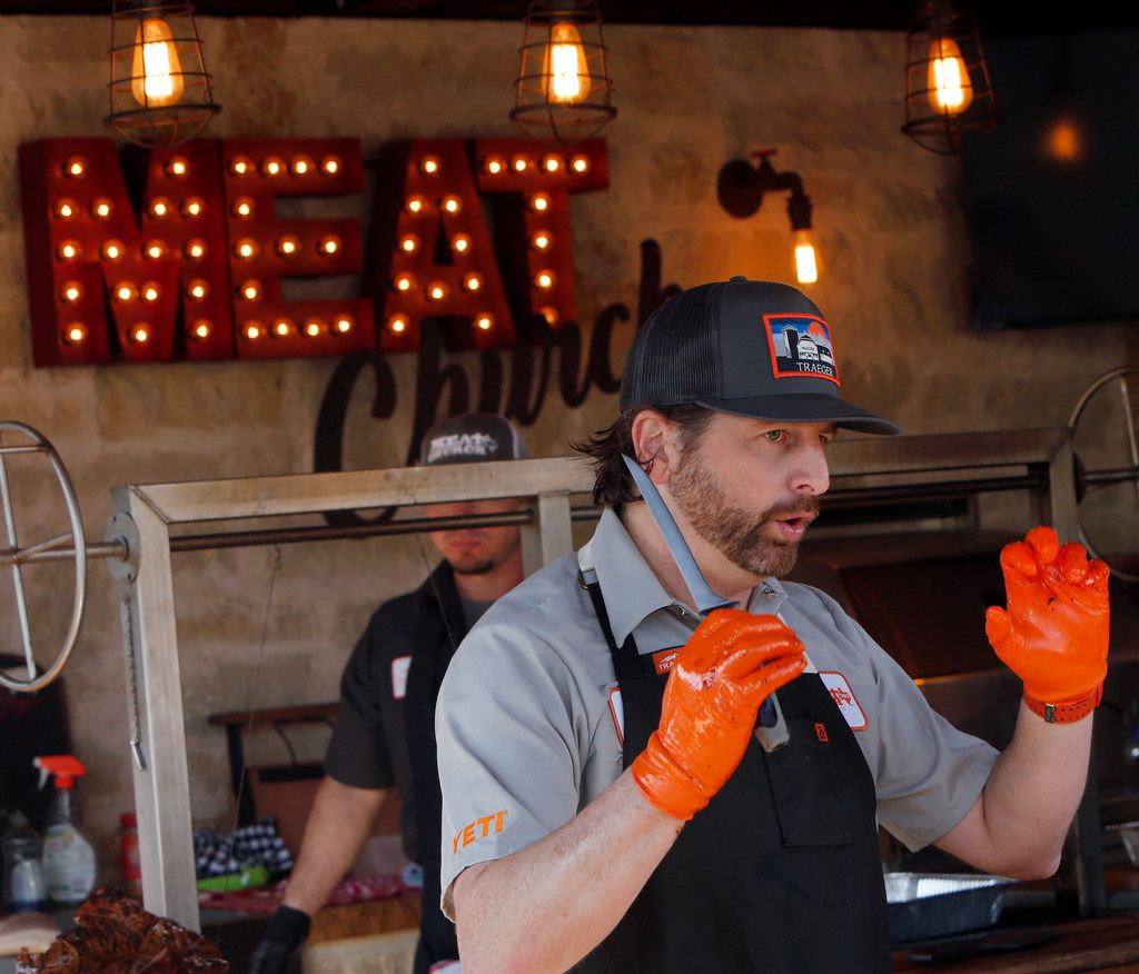 Matt Pittman describes the importance of preparation as he  demonstrates safe and effective ways of cutting the different types of meat during his outdoor barbecue cooking class in Waxahachie.