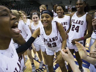 Plano celebrates a 60-46 win after a UIL 6A Region II semifinal girls basketball game between Plano and Cedar Park Vista Ridge on Friday, February 28, 2020 at Ellis Davis Field House in Dallas.
