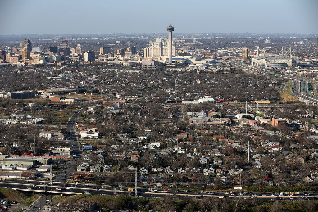 The San Antonio skyline is viewed from south to north as traffic moves along U.S. 90, bottom of the frame, Thursday, Feb. 18, 2016. ORG XMIT: MER2016031014224896