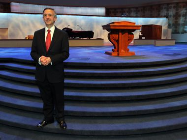 Pastor Robert Jeffress poses for a photo in the new sanctuary of the refurbished Dallas First Baptist Church on March 13, 2013.