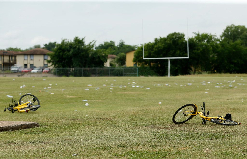 Bikes and debris on the football field at the Juanita Craft Recreation Center in Dallas.