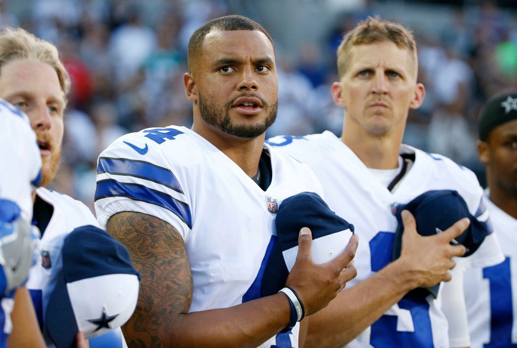 Dallas Cowboys quarterback Dak Prescott (4) and Dallas Cowboys quarterback Luke McCown (3) during the singing of the National Anthem before the Hall of Fame Game between the Dallas Cowboys and Arizona Cardinals at Tom Benson Hall of Fame Stadium in Canton, Ohio on Thursday, August 3, 2017. (Vernon Bryant/The Dallas Morning News)