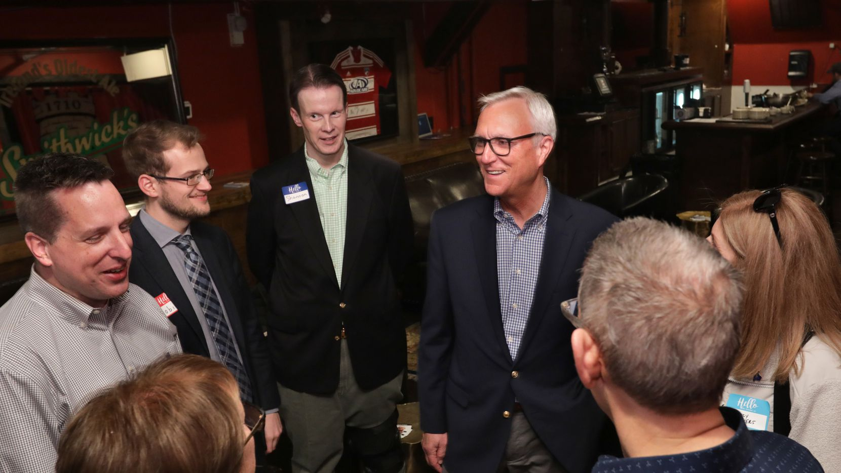 Chris Bell, center, talks to community members during a senate campaign event at The British Lion in Frisco, TX, on Nov. 16, 2019. (Jason Janik/Special Contributor)