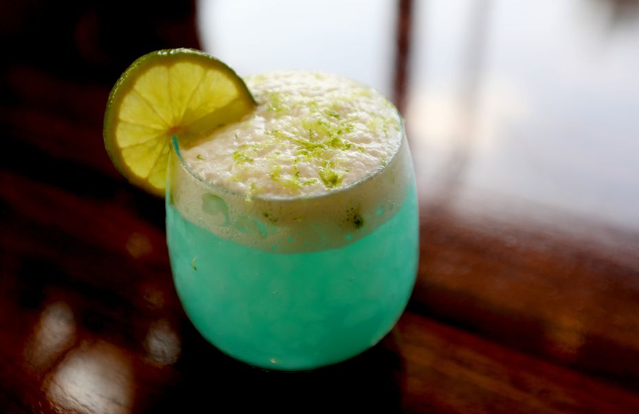 """Suburban Yacht Club's Seafoam Surfer is eye-catching. It's basically the restaurant's ocean-inspired margarita, and it's made with Casa Noble Crystal tequila, Grand Marnier, agave, lime and """"salty seafoam."""""""