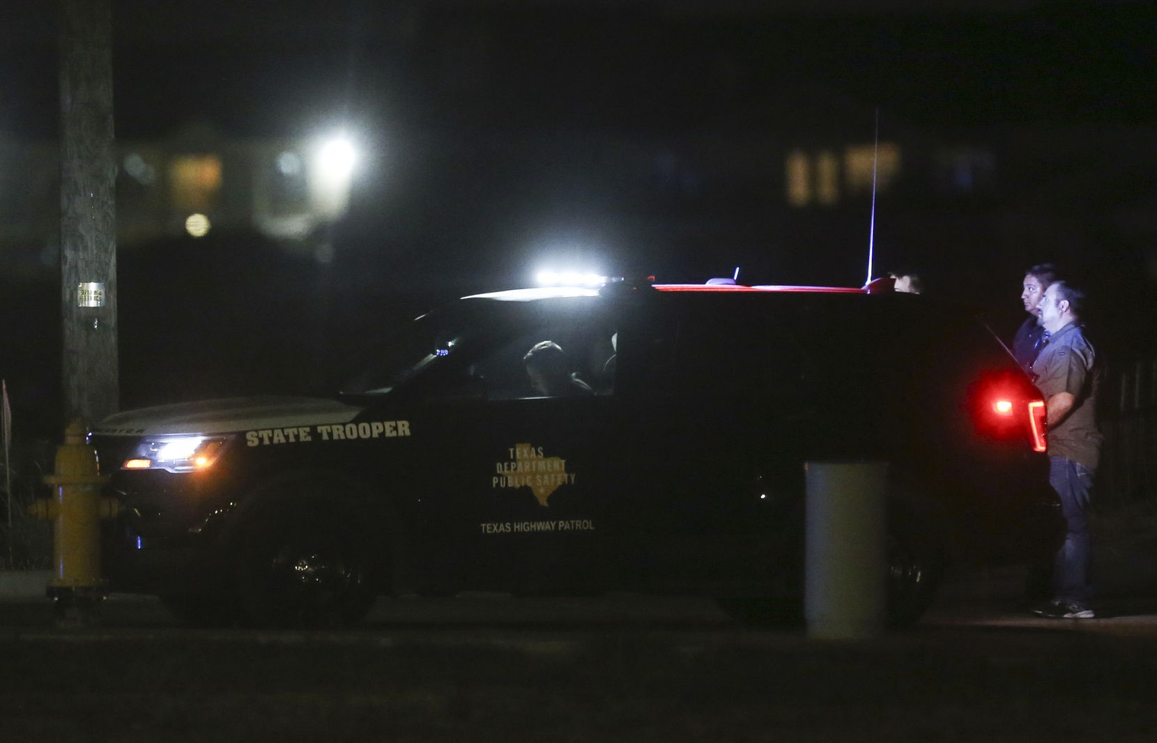 Police are seen Saturday, Aug. 31, 2019 at a Cinergy movie theatre in Odessa, Texas. At least five people died after more than 20 people were shot Saturday when a gunman hijacked a postal truck and began shooting randomly in the Odessa area of West Texas, authorities say.