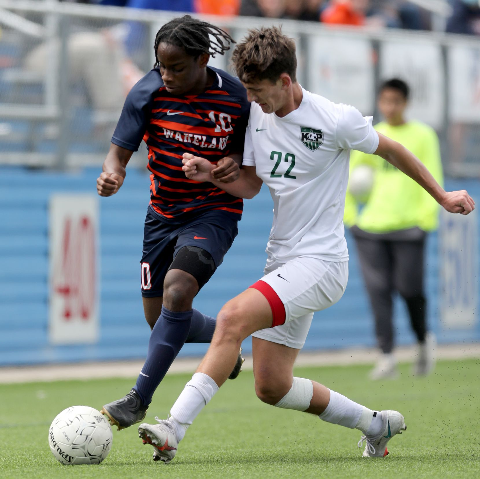 Frisco Wakeland's Marlon Williams (10) and Humble Kingwood Park's Tony Sterner (22) struggle for control of the ball during their UIL 5A boys State championship soccer game at Birkelbach Field on April 17, 2021 in Georgetown, Texas.