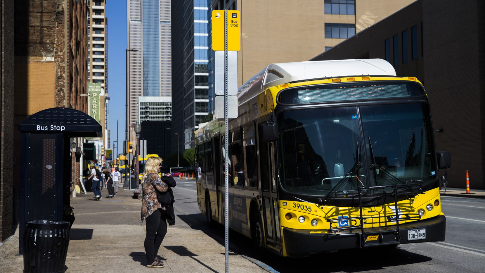 A passenger waits for a DART bus in this file photo. A bus driver narrowly avoided a stray bullet in Oak Cliff on Tuesday.