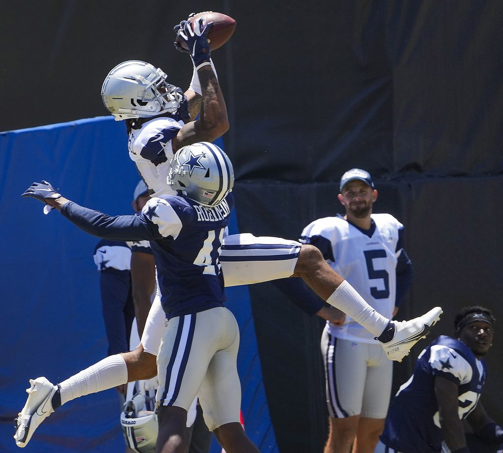 Dallas Cowboys wide receiver Osirus Mitchell (14) catches a pass over cornerback Reggie Robinson II (41) during a practice at training camp on Sunday, Aug. 1, 2021, in Oxnard, Calif.