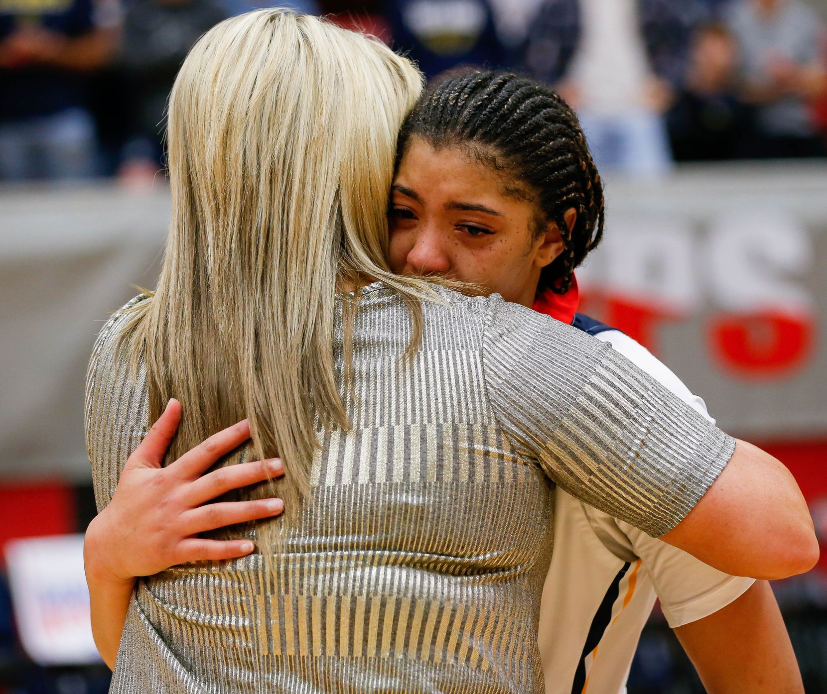 Plano Prestonwood Christian's Jordan Webster (32) hugs coach Holly Mulligan after losing a TAPPS Class 6A girls basketball state championship game against the Village School on Feb. 28, 2020 in West. Prestonwood lost 75-48.