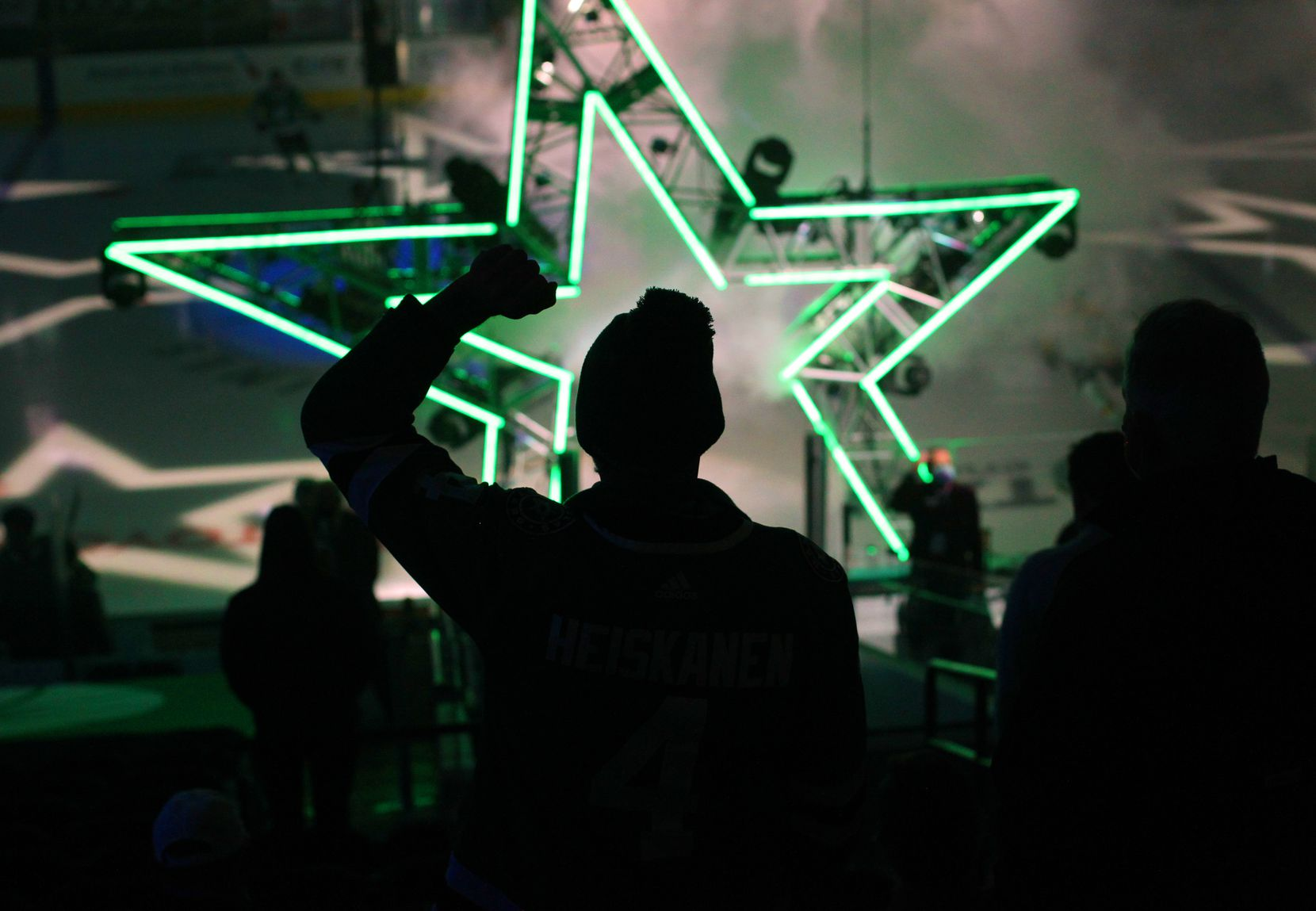 A Dallas Stars fan pumps his fist in the air as the Stars take to the ice just prior to the puck drop against the Nashville Predators. The two teams played their NHL game at the American Airlines Center in Dallas on January 24 , 2021. (Steve Hamm/ Special Contributor)