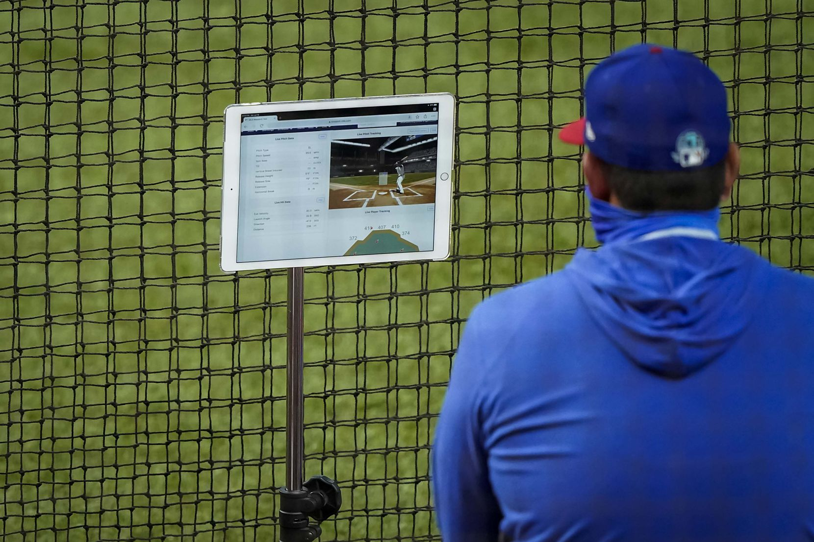 Pitching coach Julio Rangel looks over tracking data on a tablet in an intrasquad game during Texas Rangers Summer Camp at Globe Life Field on Saturday, July 18, 2020.