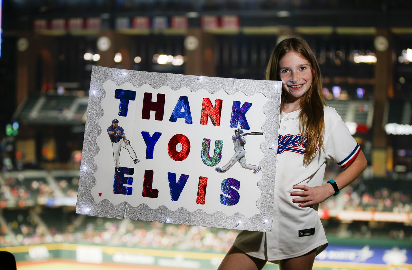 Emma Briceno, 10, a Elvis Andrus fan, poses for a photo during a baseball game between the Oakland Athletics and Texas Rangers in Arlington, Monday, June 21, 2021. (Brandon Wade/Special Contributor)