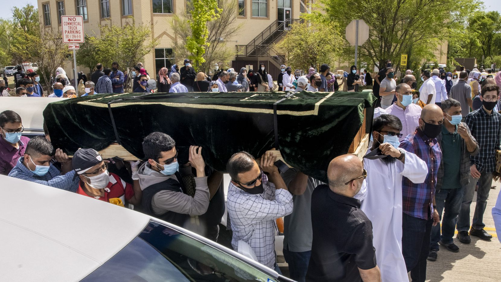 Men at the Islamic Association of Allen carried the caskets Thursday of the six family members who died in an apparent murder-suicide in Allen.