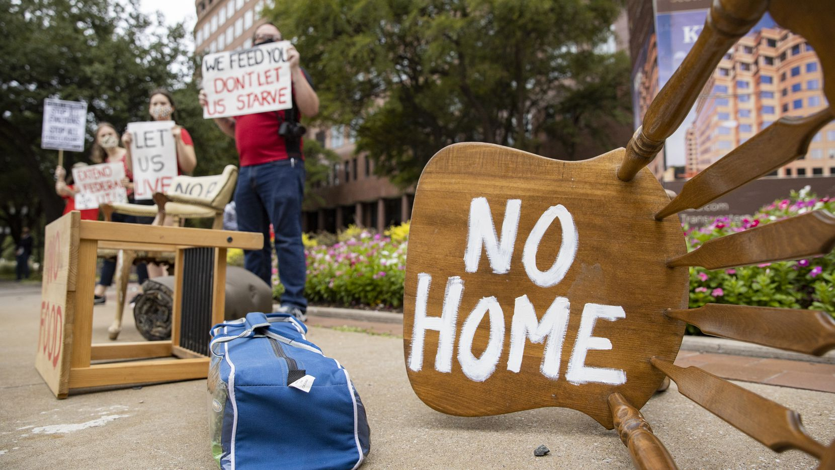 "Protesters place furniture and rally outside the Dallas office of Sen. John Cornyn ""to show him the reality of the eviction crisis"" in this Sept. 1 file photo."