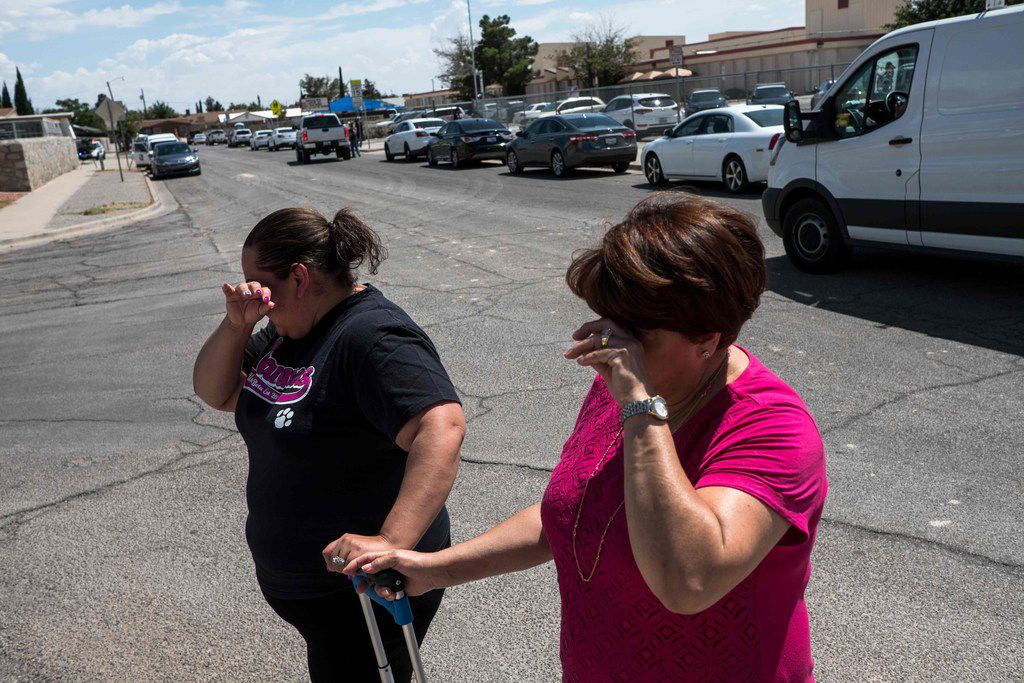 Residents Erica Rios, 36, and Alma Rios, 61, cry outside a reunification center at MacArthur Elementary School, following a deadly mass shooting, in El Paso, Texas, on August 3, 2019. - A gunman armed with an assault rifle killed 20 people Saturday when he opened fire on shoppers at a packed Walmart store in the latest mass shooting in the United States.
