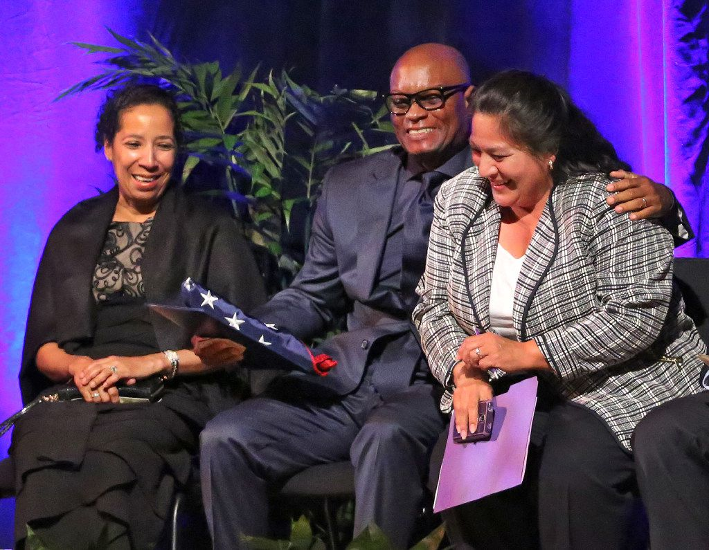 Monica Alonzo (right) shares a laugh with former Dallas Police Chief David O. Brown during his retirement ceremony, along with Brown's wife Cedonia (left).