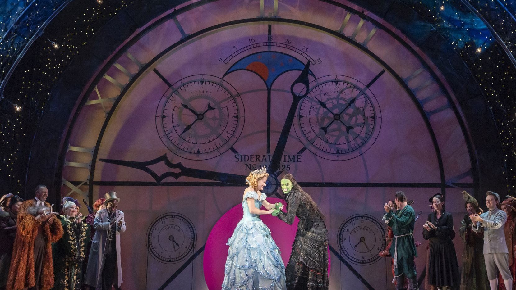"""Glinda (Allison Bailey), left, and Elphaba (Talia Suskauer) appear in a curtain call during a dress rehearsal for """"Wicked"""" at Dallas Summer Musicals in August."""