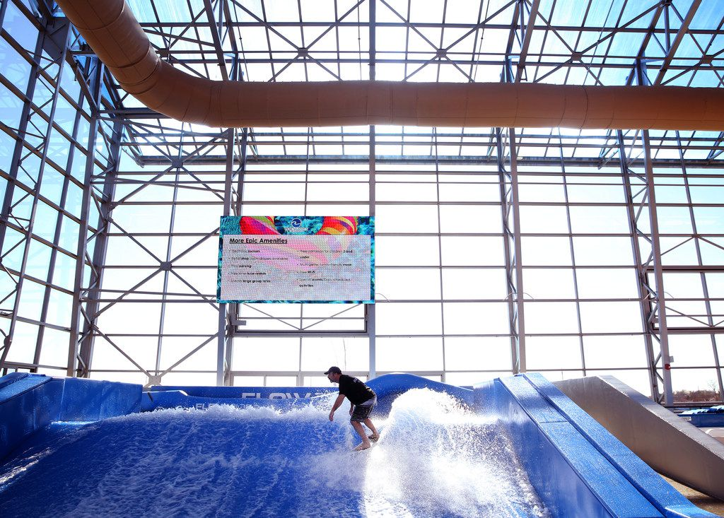 Mike Pappy, flow dog coach, demonstrates how to surf during a media day at the new Epic Waters Indoor Waterpark in Grand Prairie, Texas on Monday, Jan. 8, 2018. The city-owned waterpark is the largest in North America under a single retractable roof. (Rose Baca/The Dallas Morning News)