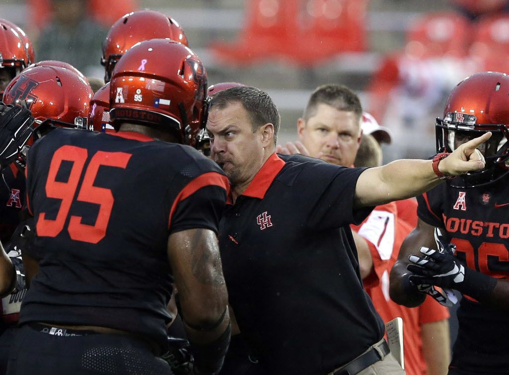 In this Oct. 31, 2015, file photo, Houston head coach Tom Herman, center, revs up his players before the first half of an NCAA college football game against the Vanderbilt in Houston.  If Tom team pulls the upset against Oklahoma on Sept. 5, 2016, it could vault the Cougars and by extension the entire AAC into the playoff conversation. Lose and the playoff pretty much comes off the table for the Cougars, in week one!  (AP Photo/Pat Sullivan, File)