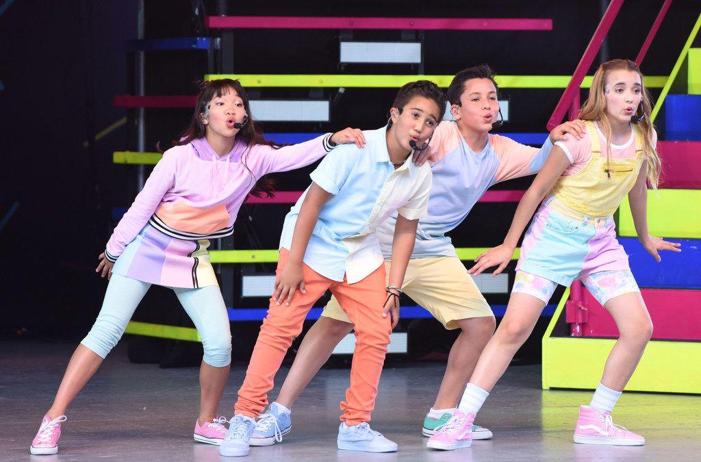 Members of Kidz Bop perform kid-friendly songs and dance.