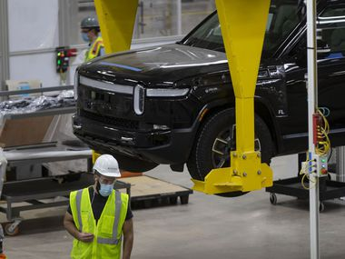 Vehicles are assembled and tested on April 14 at the Rivian plant in Normal, Ill. Rivian pushed its production launch back to September, in part because of the semiconductor chip shortage roiling the auto industry.