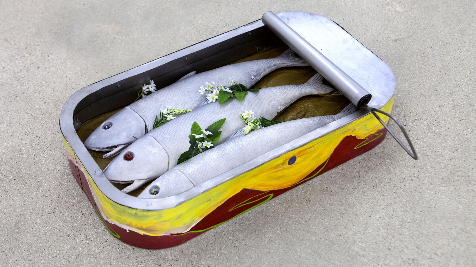 'Middle Voice,' Justine Melford-Colegate's sculpture of three sardines in a tin, is among the works on display at And Now gallery through April 3.