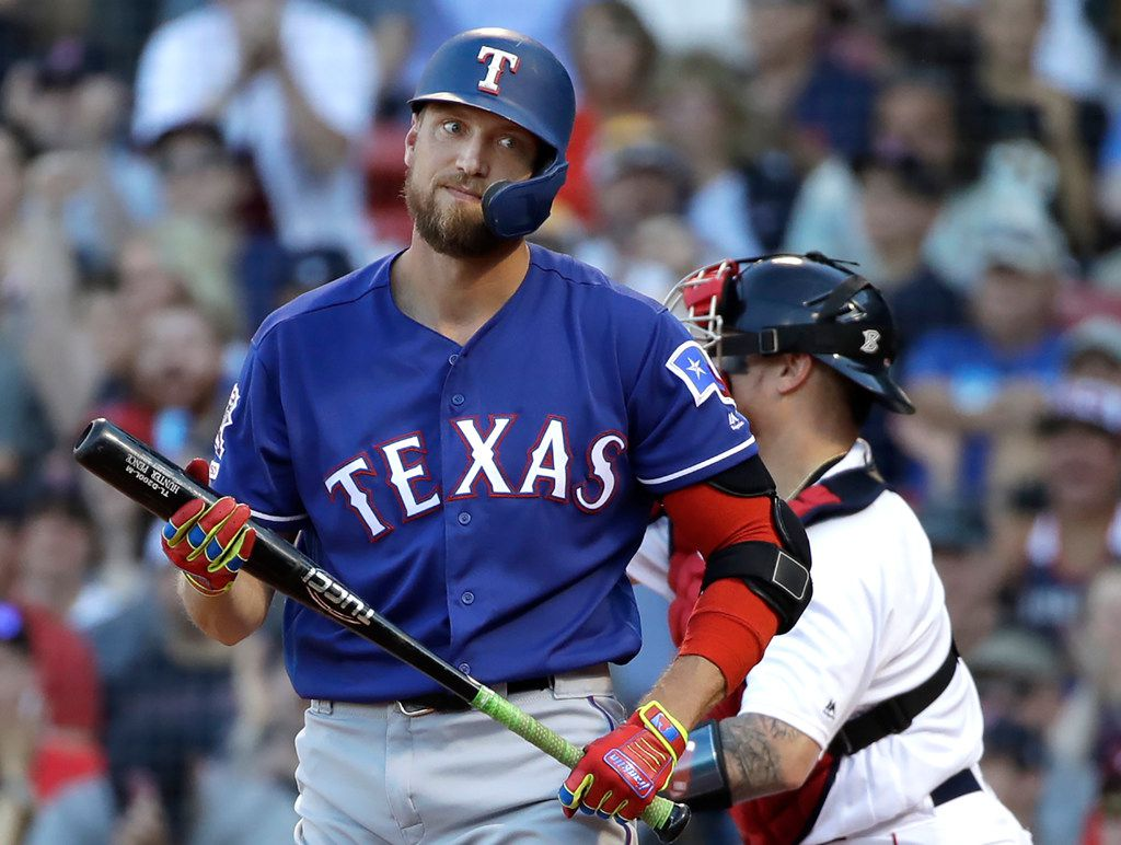 Texas Rangers' Hunter Pence reacts after striking out and leaving runners on, to end the eighth inning of a baseball game against the Boston Red Sox at Fenway Park, Wednesday, June 12, 2019, in Boston. (AP Photo/Elise Amendola)