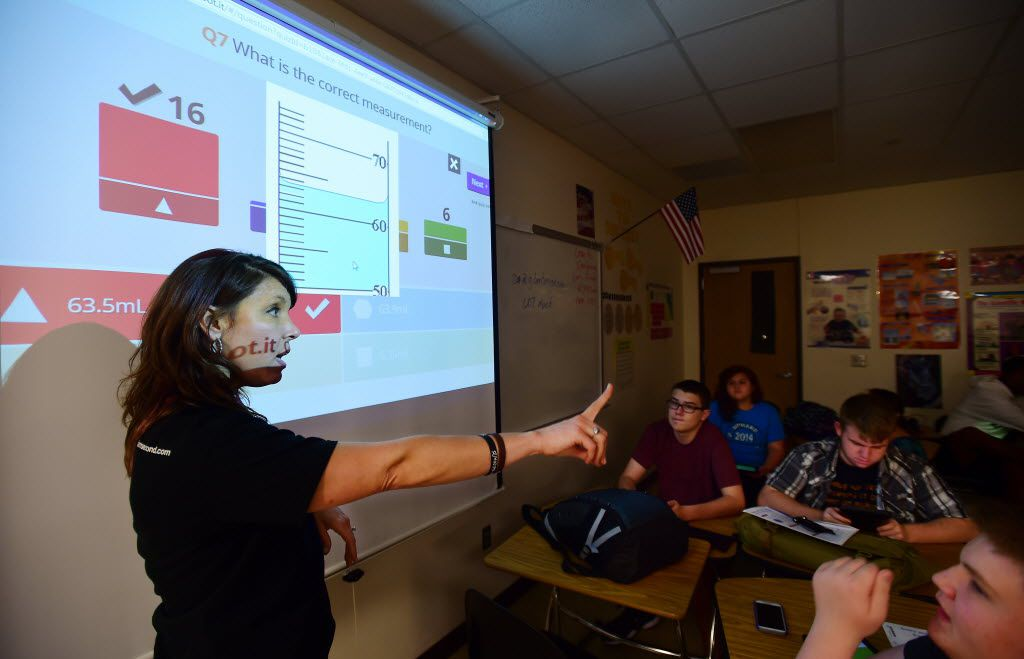 Guyer chemistry teacher Jeana Wesson works with her students using Google Classroom on Sept. 19, 2014, in Denton. (Al Key/Denton Record-Chroinicle)