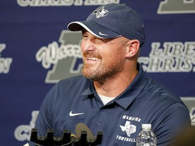 Argyle Liberty Christian head coach Jason Witten laughs during a press conference on Friday, Aug. 20, 2021, in Argyle, Texas.