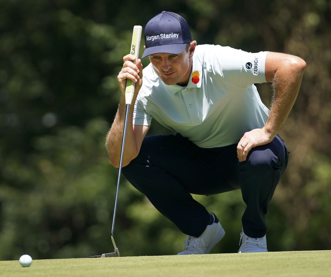 PGA Tour golfer Gary Woodland eyes his line as he putts on No. 8 during the second round of the Charles Schwab Challenge at the Colonial Country Club in Fort Worth, Friday, June 12, 2020.  The Challenge is the first tour event since the COVID-19 pandemic began. (Tom Fox/The Dallas Morning News)