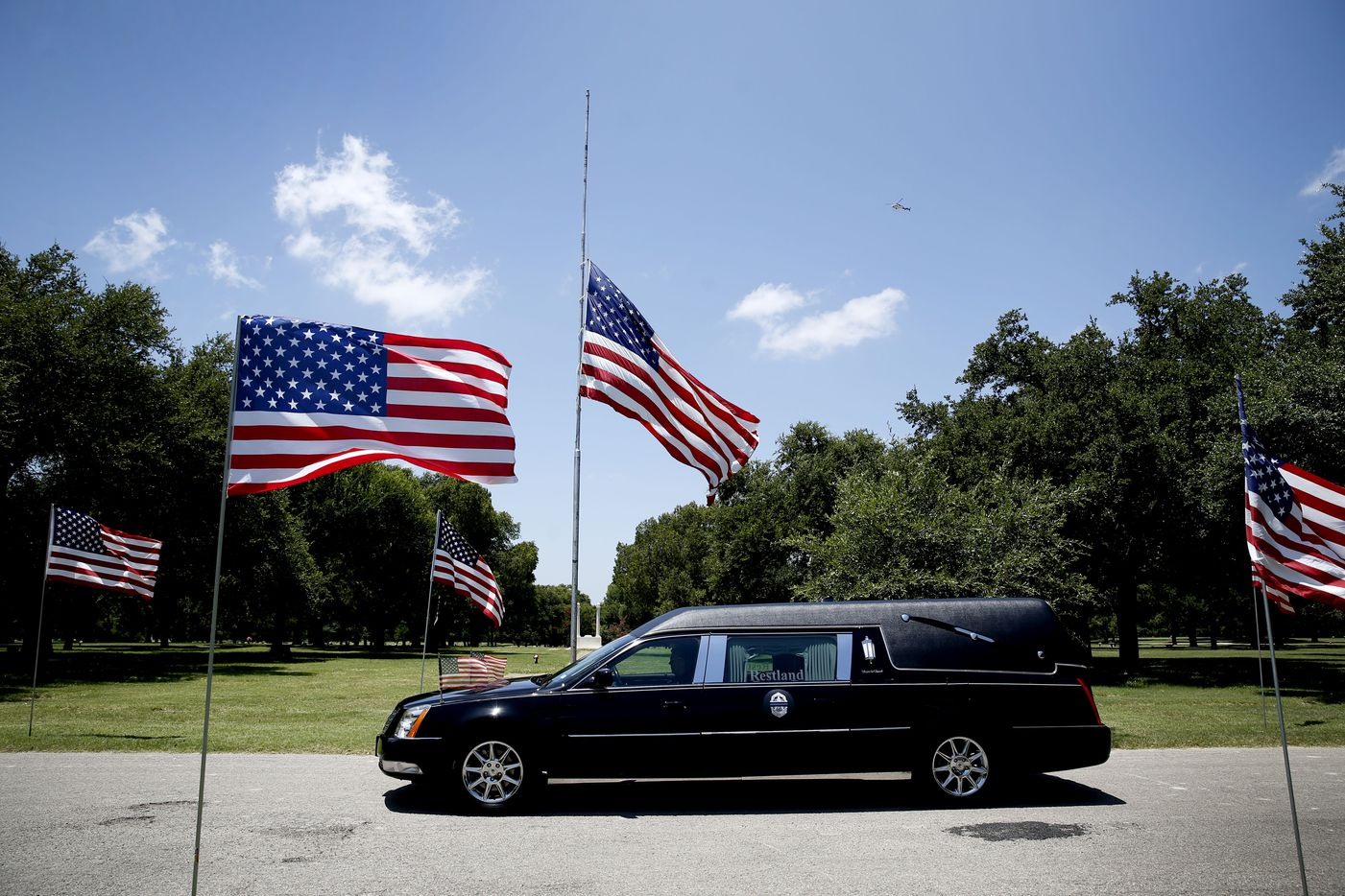 The hearse passes in the funeral procession for the burial for fallen Dallas police officer Lorne Ahrens in the Garden of Honor at Restland Funeral Home and Cemetery in Dallas on July 13, 2016. Ahrens and four other officers were gunned down during an ambush on police in downtown Dallas.