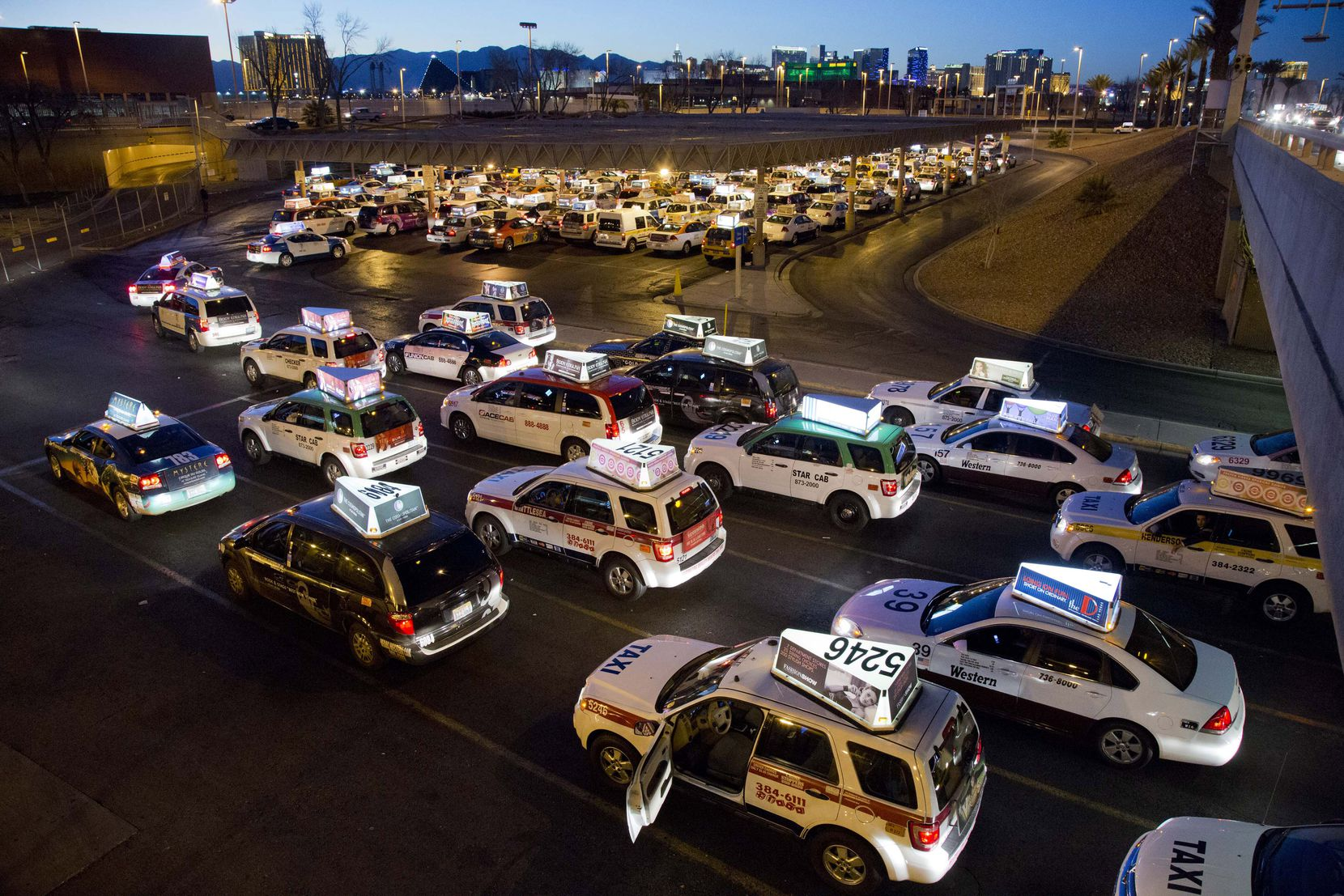 Taxis await their turn to pick up passengers at McCarran International Airport in Las Vegas.