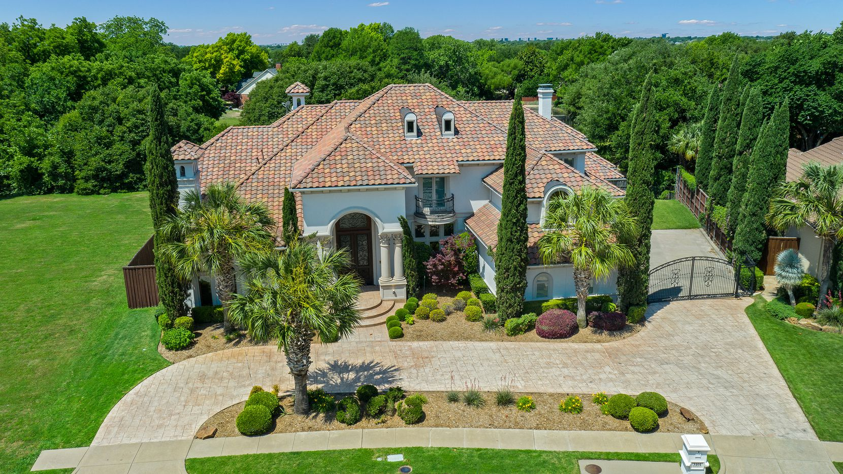The Mediterranean-style estate home with lake views at 3101 Harvard Court in Plano is offered at $1,895,000.