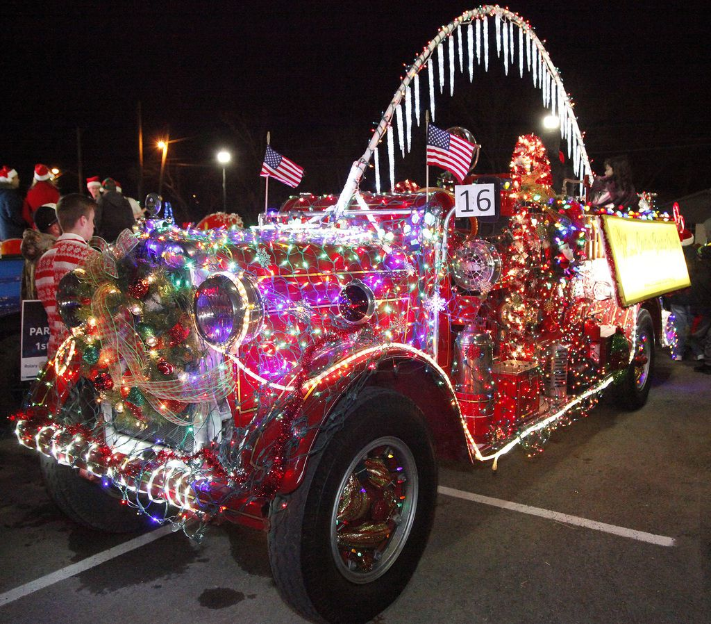 A decorated antique fire engine is ready to roll in the 2018 McKinney Christmas Parade of Lights in downtown McKinney.