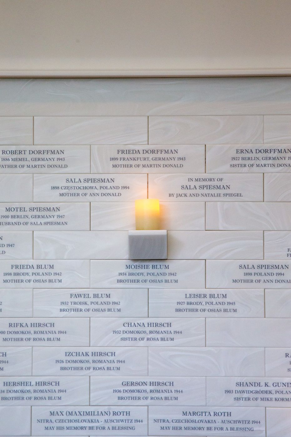 Names of Holocaust victims, survivors and their family members are carved in stone in the Memorial and Reflection Room in the new Dallas Holocaust and Human Rights Museum.