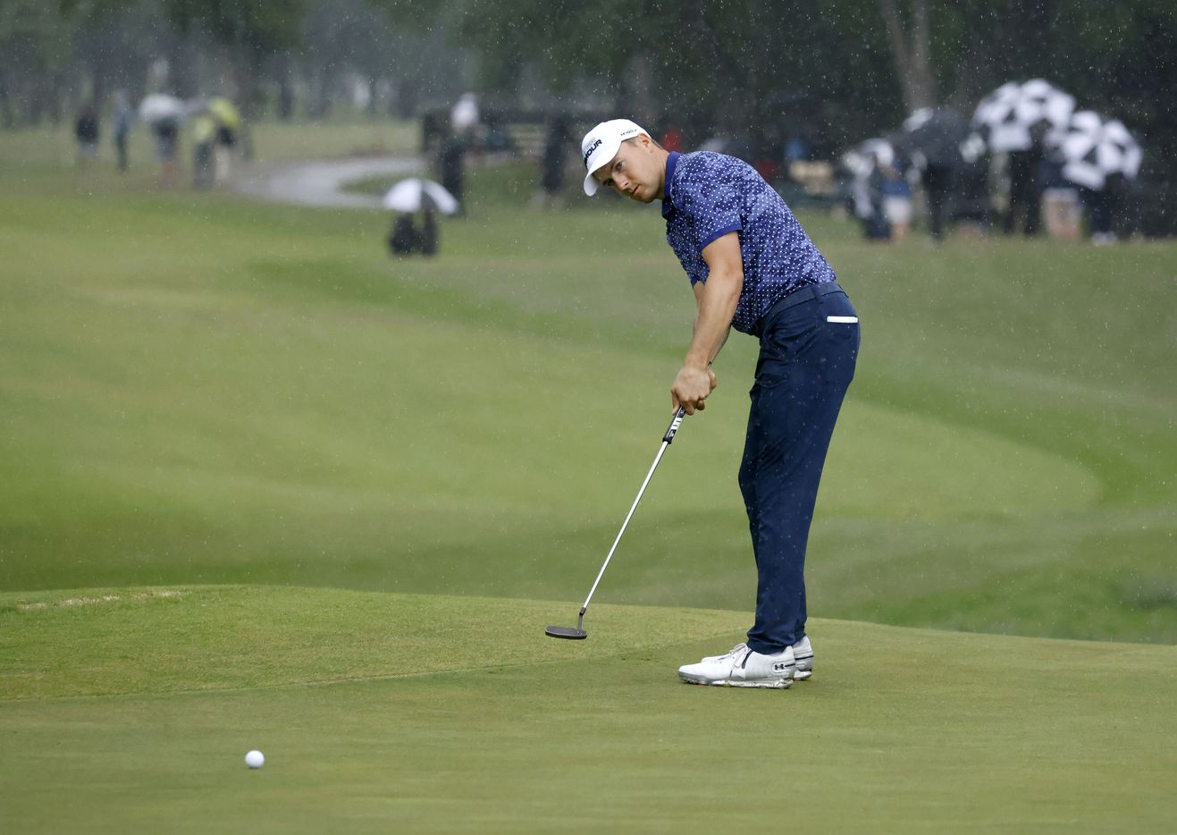 Jordan Spieth watches his putt as it rains on the 9th hole during round 4 of the AT&T Byron Nelson  at TPC Craig Ranch on Saturday, May 16, 2021 in McKinney, Texas. (Vernon Bryant/The Dallas Morning News)
