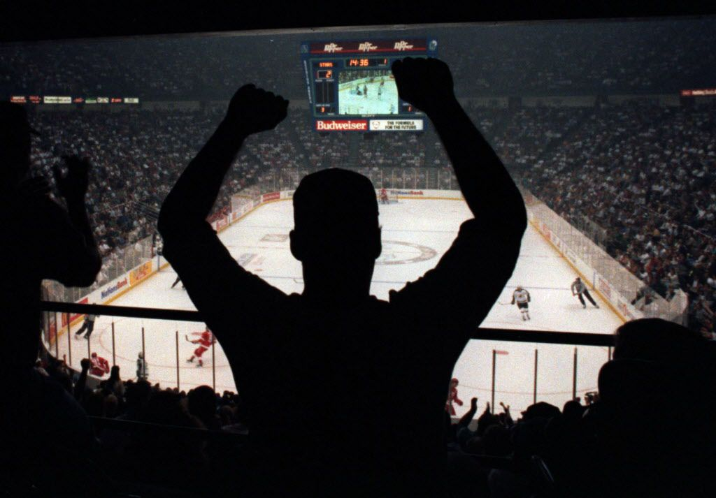 10/5/1993.. A Dallas Stars hockey fan cheers on his team, which is playing against Detroit in Reunion Arena.