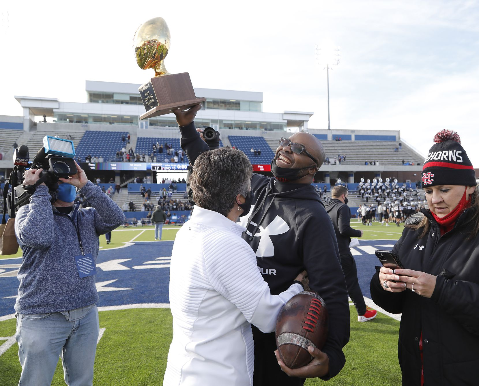 Cedar Hill High School head coach Carlos Lynn hoists the trophy after the win as Denton Guyer High School played Cedar Hill High School in the Class 6A Division II, state semifinal at McKinney ISD Stadium in McKinney on Saturday, January 9, 2021.  (Stewart F. House/Special Contributor)