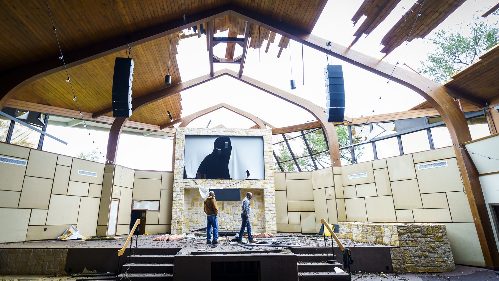 Northway Church lead pastor Shea Sumlin, right, surveys the damage to the sanctuary with facilities associate Robert Lusk on Thursday.