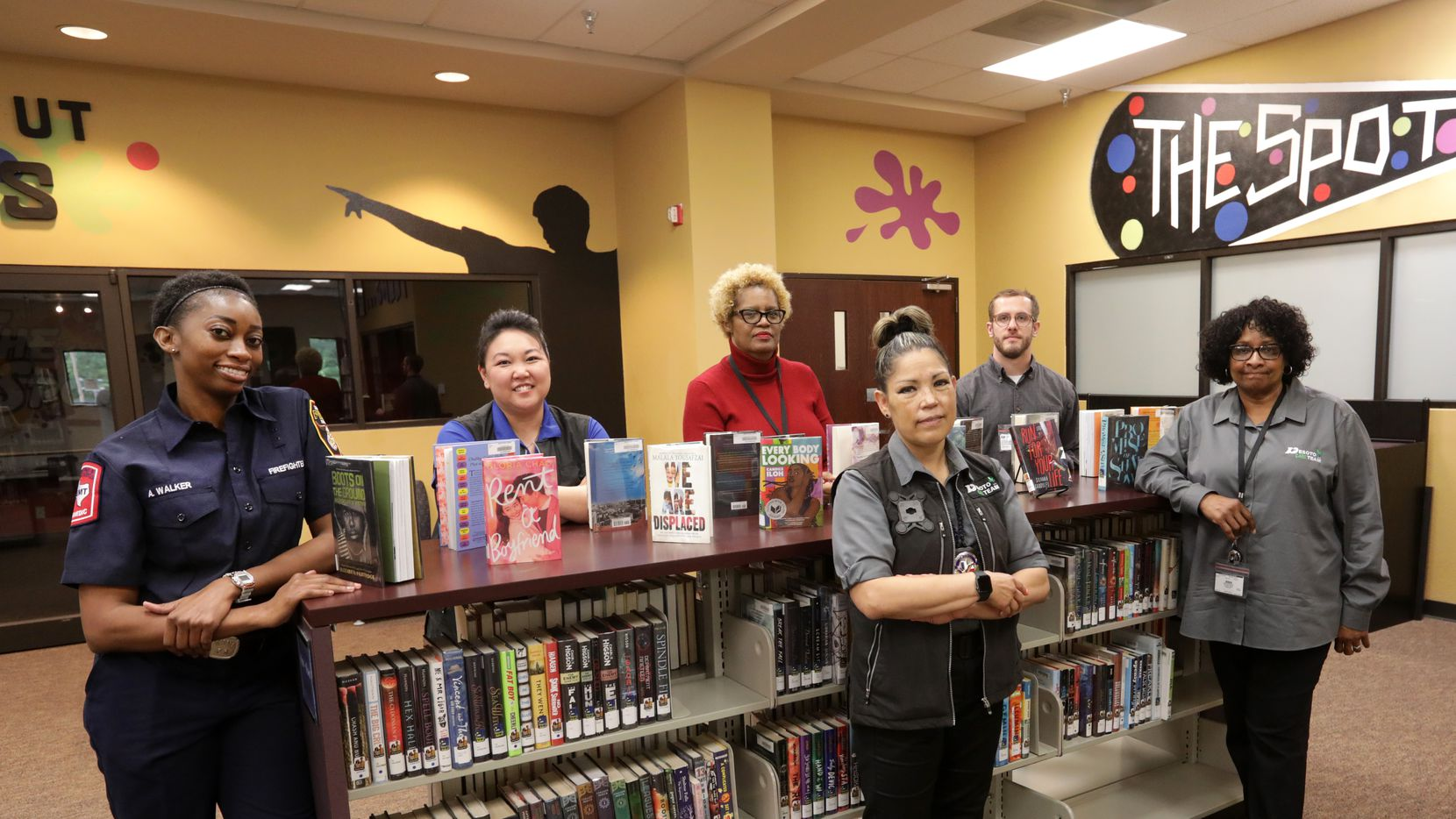Members of the DeSoto Care Team pose for a photograph at the Library in DeSoto, TX, on May 24, 2021. The Care Team includes police officers, health care experts and a victim's advocate.  (Jason Janik/Special Contributor)