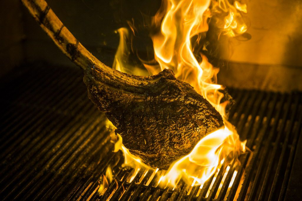 The Tomahawk Steak, 48oz bone-in rib eye for two, being grilled by Chef de Cuisine Jonathan Rivera at LAW at the Four Seasons Resort and Club Dallas at Las Colinas on Wednesday, March 30, 2016, in Irving. (Smiley N. Pool/The Dallas Morning News)